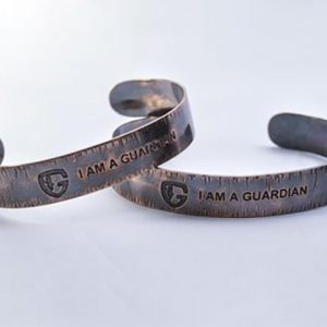 "handmade copper cuff with ""I am A Guardian"" etched in it"
