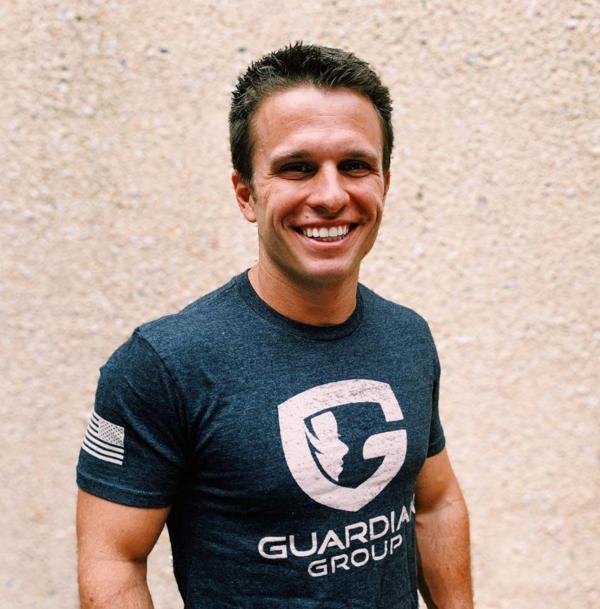 man wearing the Guardian shirt