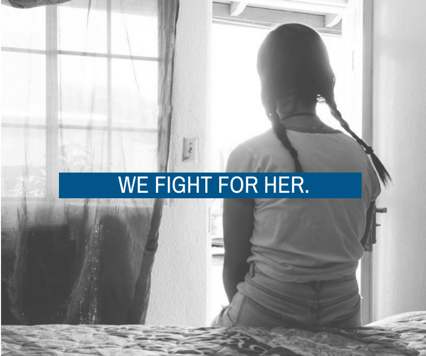 girl sitting on hotel bed with the words we fight for her overlayed