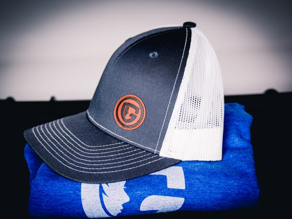 hat with Guardian group shield patch